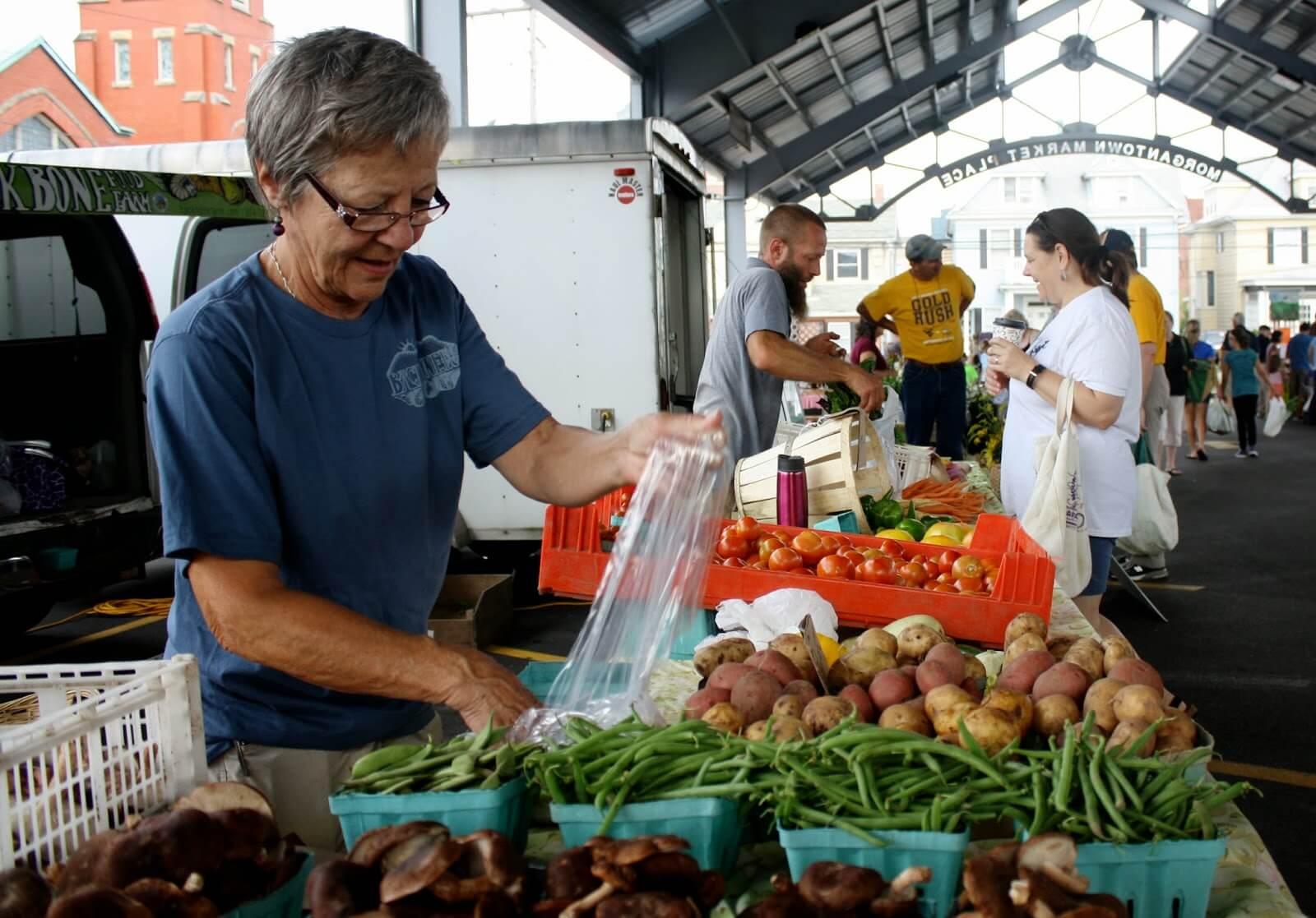 sorting vegetables at morgantown farmers market