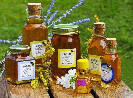 six jars of local wildflower honey, a mix of all the honeys of the season